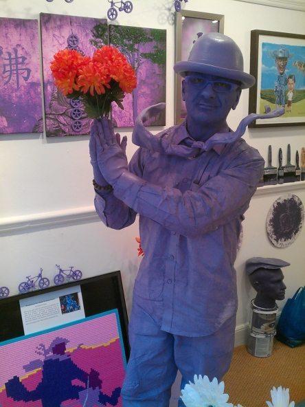 Purpleman holds orange flowers