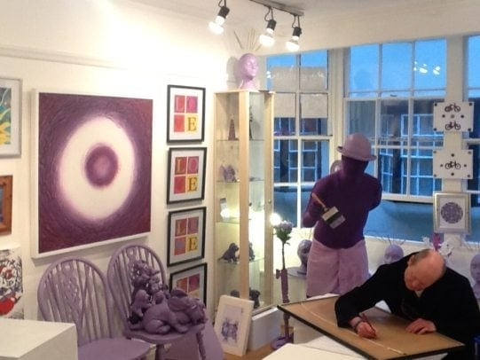 Dexter signs his artwork, Lounge Grafitti 70's with Purpleman observing