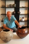 Stephen Murfitt with white and lustred raku vessels
