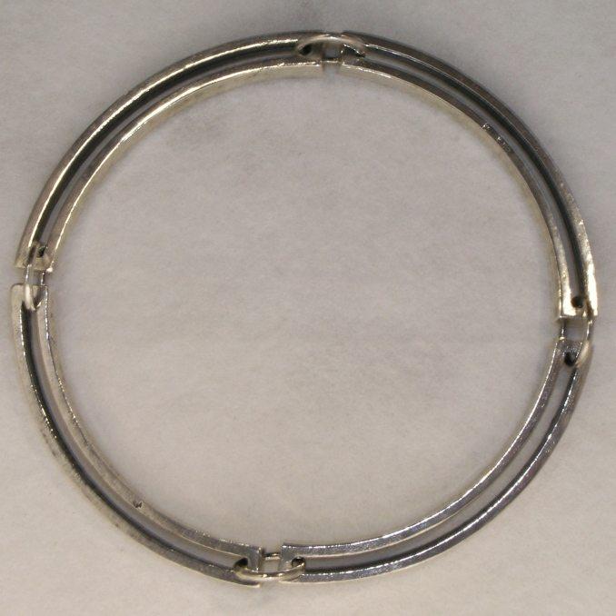 Silver articulated four link bracelet by Mark Peter Fraser