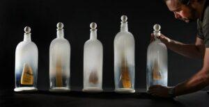 Glass bottles with suspended 'scrimshaw'