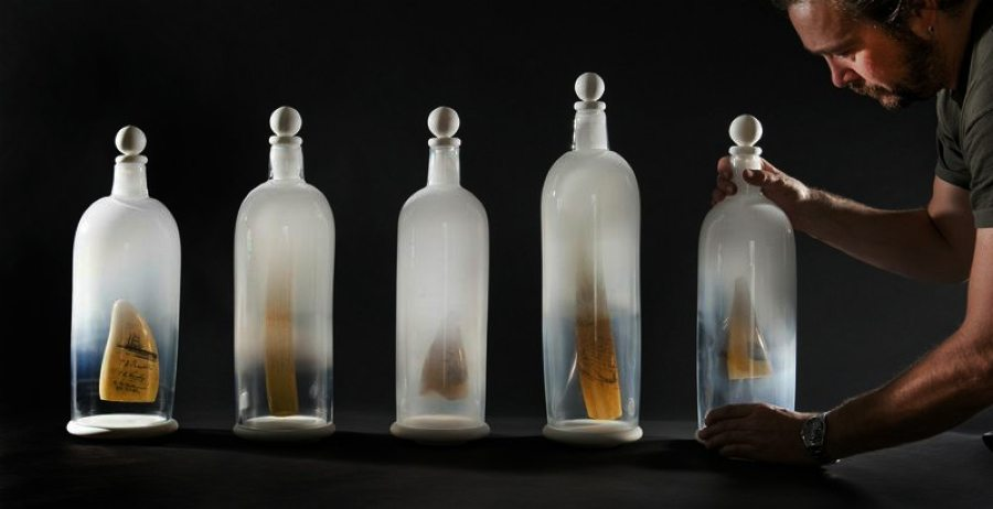 Glass bottles with suspended 'scrimshaw'