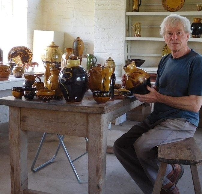 Clive Bowen at Shebbear Pottery with a collection of pots for Pyramid Gallery