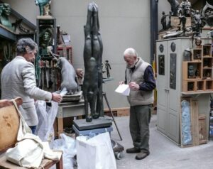 Terry Brett wrapping bronzes, John Mills sorting