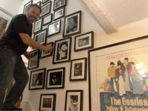 Ian Astle hanging photographic portraits