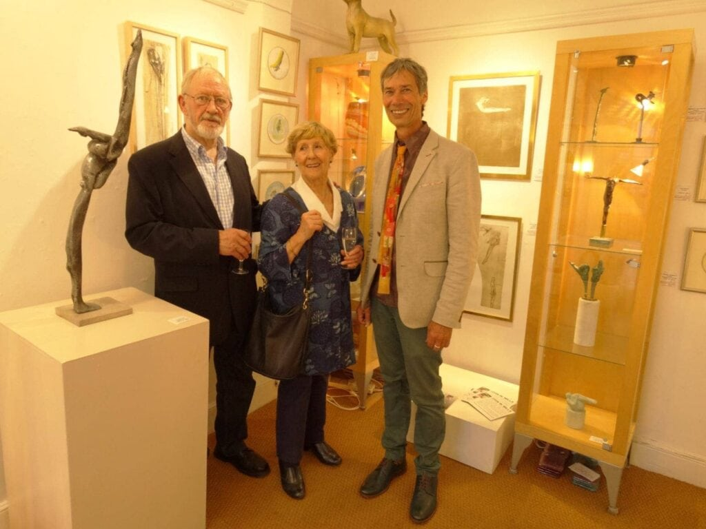 Artist John Mills with his wife Jo, and Terry at the opening of his 'Divers' exhibition