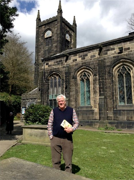 The author at St. Mary's Church, Luddenden, Halifax, standing by his ancestors' grave
