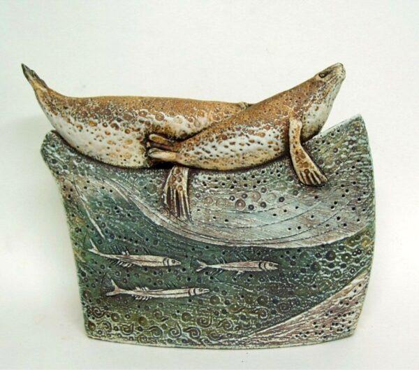 seals with sand eels sculpture